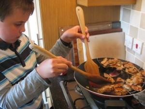 Aidan - cooking pork stir-fry